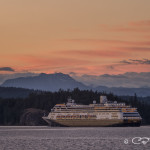 Cruise ship at sunset headed north from Campbell River towards the Seymour Narrows